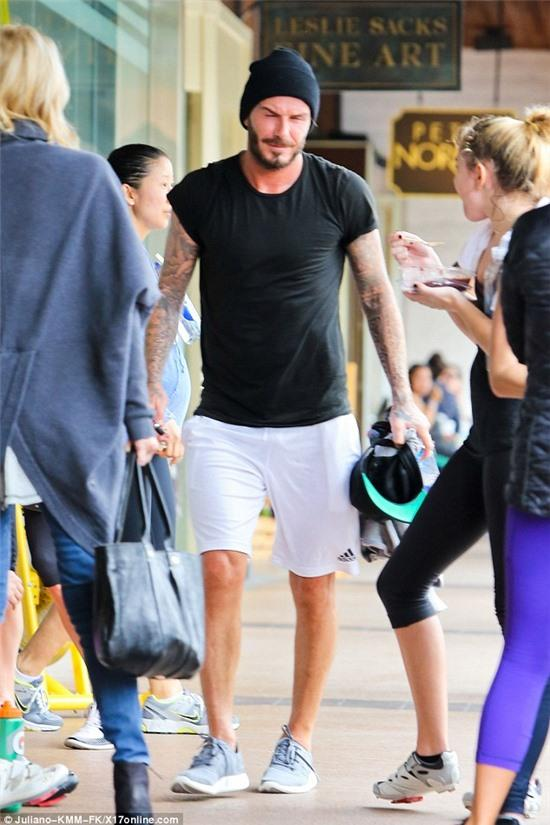 Not so chubby! David Beckham showed off his athletic physique in Los Angeles on Wednesday