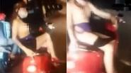 Thiếu nữ xinh đẹp thản nhiên lột áo chip khoe ngực trên xe máy gây shock