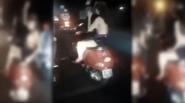 Phản cảm nhóm thanh niên hò reo cổ vũ cô gái lột đồ khoe ngực trên phố