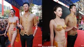 Cặp người mẫu Trung Quốc gây sốc vì trình diễn nội y bằng vàng