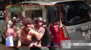 Tài xế taxi bỏ chạy bị người dân bức xúc đập phá xe và lột áo
