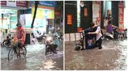 """Mưa 30 phút, đường phố Hà Nội đã chìm trong """"biển"""" nước"""