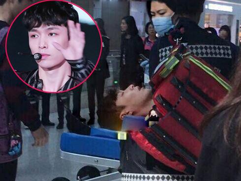 Người hâm mộ náo loạn vì thành viên EXO ngất xỉu giữa sân bay