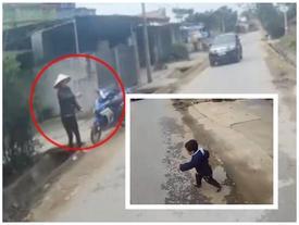Mẹ vẫy tay gọi qua đường khiến con suýt bị xe máy tông