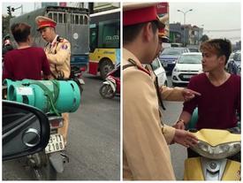 """Thanh niên chở gas """"hổ báo"""" bật tanh tách CSGT khi bị thổi phạt"""