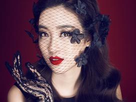 Hoa Hậu Đỗ Mỹ Linh sang trọng và quý phái với trang phục màu đen và ren