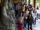 Tiền rải đầy mặt trống đồng 70 tấn ở chùa Bái Đính
