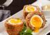 Anh: Bạn có thể tưởng tượng ra độ ngon của món Scotch Eggs bằng cách đọc phương pháp chế biến của nó. Những quả trứng được luộc sơ, nhúng vào nước lạnh rồi bóc vỏ rồi bọc với xúc xích trộn vụn bánh mì trước khi đem chiên giòn trong dầu nóng. Nếu làm khéo, bạn sẽ có món ăn tuyệt ngon với lớp thịt siêu ngon mà quả trứng vẫn còn lòng đào.