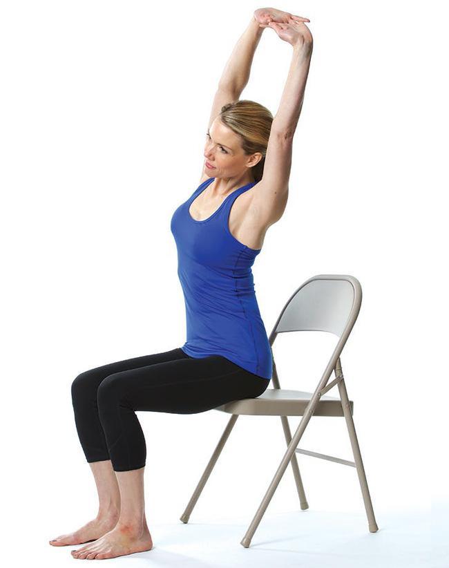 Giảm stress ngay tức khắc với bài tập yoga trên ghế này - Ảnh 4.