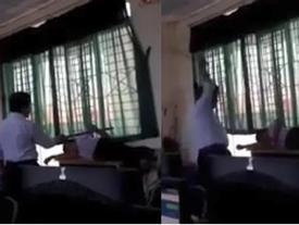 Thầy giáo dùng gậy đánh học sinh trong lớp học