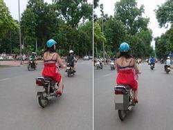 Cô gái 'mặc váy như không' vô tư chạy xe trên đường
