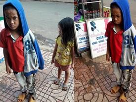 Hình ảnh bé trai bị xích chân giữa chợ khiến nhiều người bức xúc