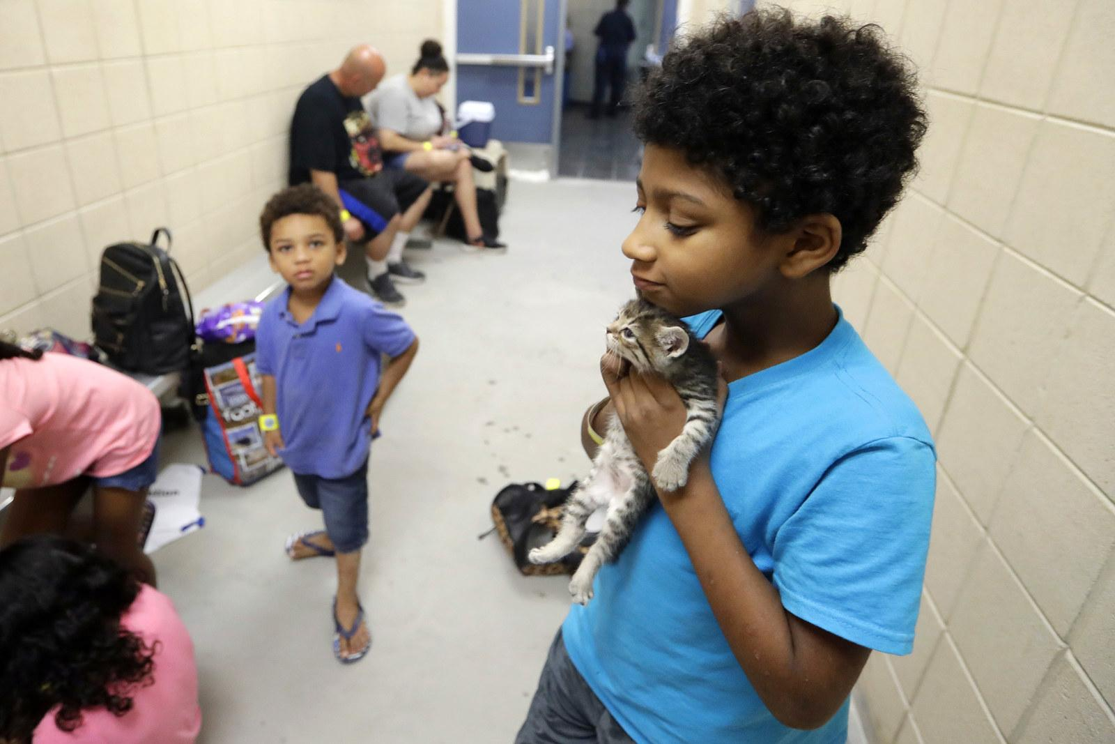 Keedan Garcia, 8, holds his kitten as he waits with his family to be evacuated in Corpus Christi, Texas, on Aug. 25.