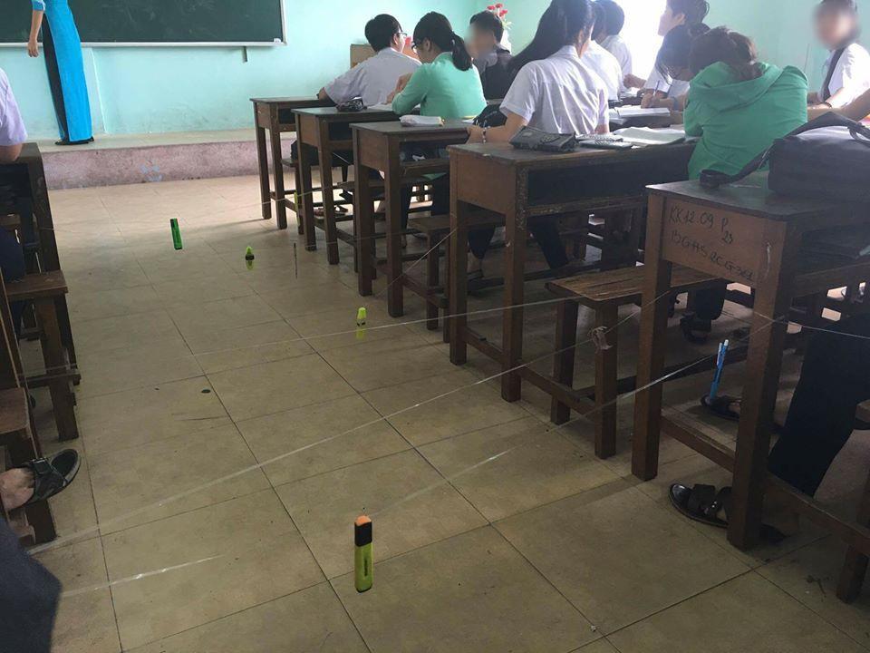 Màn giăng dây như ma trận để cô giáo không thể đi xuống kiểm tra vở của HS cấp 3-1