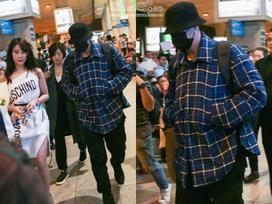 So Ji Sub mặc áo rộng thùng thình, che kín mặt, xuất hiện chớp nhoáng khi đến Việt Nam