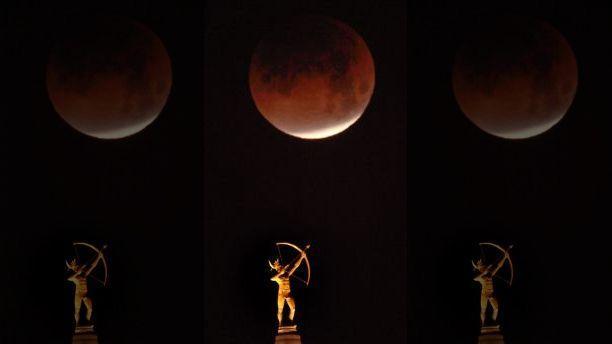 Hình ảnh ẤN TƯỢNG nhất trong ngày: Sau 152 năm, siêu trăng thế kỷ khiến người yêu thiên văn điên đảo-3