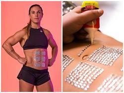 Nữ vận động viên gắn hàng trăm viên kim cương cho bụng 6 múi