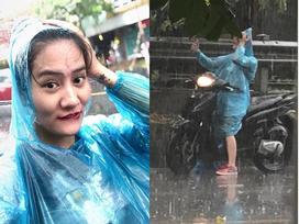Tranh thủ chụp ảnh trong cơn mưa hiếm hoi của Hà Nội, cô gái bỗng dưng hot nhất hôm nay