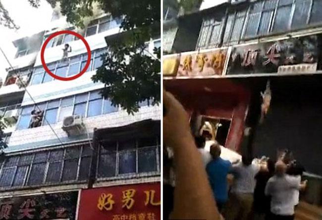 Hai đứa trẻ thoát chết nhờ mẹ ném qua cửa sổ căn hộ bốc cháy-1