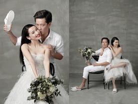 Trường Giang Nhã Phương mang dép tổ ong chụp hình cưới