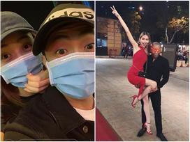 'Đi bão' độc đáo như sao Việt: Đại gia chở bạn gái bằng xe máy, mỹ nữ được trai lạ bế bổng giữa phố đông