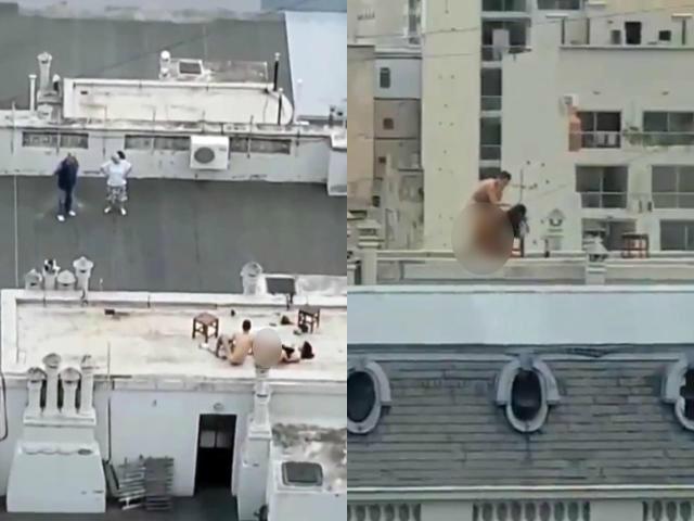 Cặp đôi gây shock khi bày trò ân ái trên sân thượng, biết có người quay lén còn thản nhiên vẫy tay chào-1