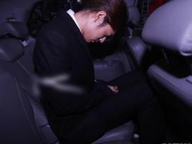 Jung Joon Young bị trói áp giải vào đồn cảnh sát sau bê bối quay lén và phát tán clip sex