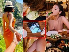 Hoa hậu Kỳ Duyên chối bay chối biến khi bị phát hiện đặt ảnh Minh Triệu làm hình nền điện thoại