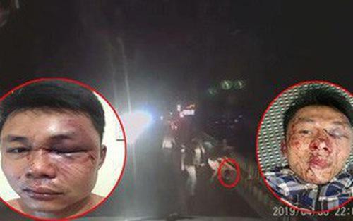 Clip: Chỉ vì bấm còi xin đường, 2 tài xế container bị nhóm côn đồ đánh bầm dập, mặt mày be bét máu-2
