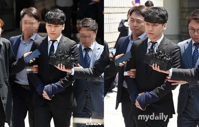 Seungri bị trói và còng tay khi rời tòa án, có thể ở tù 2 - 3 năm-1
