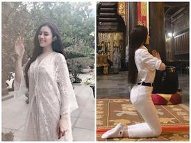 Sau bộ đồ bó sát như đang tập yoga, Thư Dung giờ còn táo bạo hơn khi diện hẳn váy ren xuyên thấu đi lễ chùa