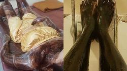 Cô gái trẻ tắm trắng bằng cách bôi người đen xì rồi quấn nilon như ướp xác khiến ai nhìn cũng sợ hết vía