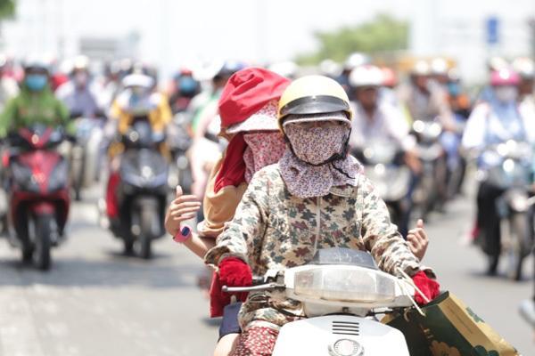 Dự báo thời tiết 20/6, Hà Nội ngoài trời nắng nóng 40 độ-1