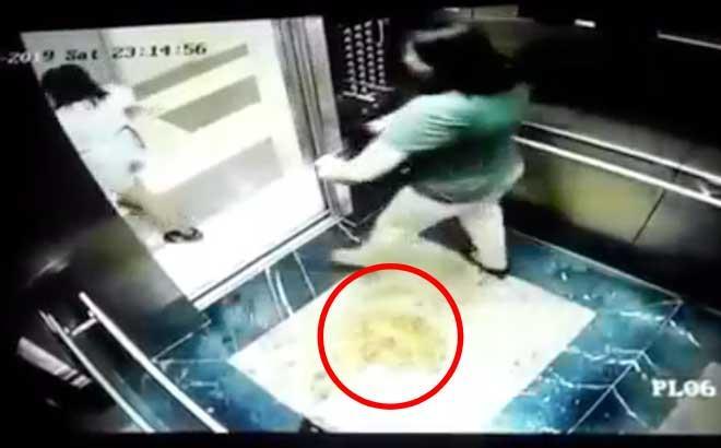 KHÔNG THỂ SỐC HƠN: Trong thang máy chung cư giữa Hà Nội, 2 phụ nữ dùng mũ bảo hiểm che camera để... đi tè-2