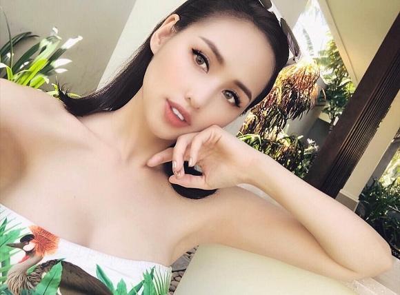 Khoe vòng 1 nở nang như muốn bung ra khỏi bikini, Tâm Tít bị hỏi vặn: Đã xin phép chồng đăng ảnh này chưa?-2