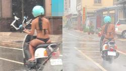 Diện bikini nhỏ xíu chỉ đủ che chắn vùng nhạy cảm rồi vô tư dạo phố ngày mưa, cô gái trẻ bị ném đá 'sấp mặt'