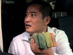 Người ôm tiền cố thủ trên chiếc Mercedes GLS 5 tỷ là ai?
