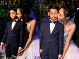 ẢNH HOT NHẤT NGÀY: Cô dâu Đàm Thu Trang âu yếm hôn má bé Subeo trong tiệc cưới