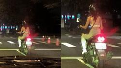 Chỉ mặc áo lót rồi lái xe máy phi ầm ầm trên phố, cô gái trẻ khiến người xem choáng váng không thốt thành lời