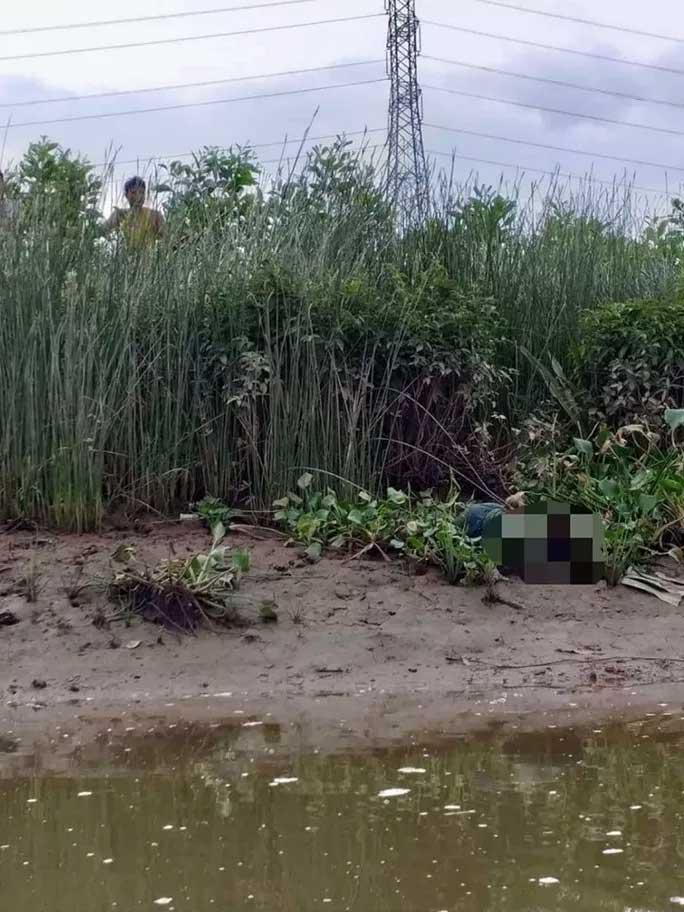 Bàng hoàng phát hiện thi thể bé trai nằm ở bờ sông-1
