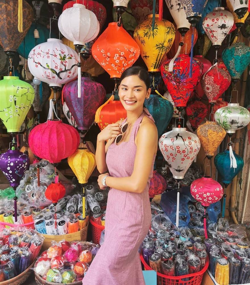 Hoa hậu Hoàn vũ bất ngờ diện áo dài nền nã, khoe nhan sắc xinh đẹp giữa phố cổ Hội An-2