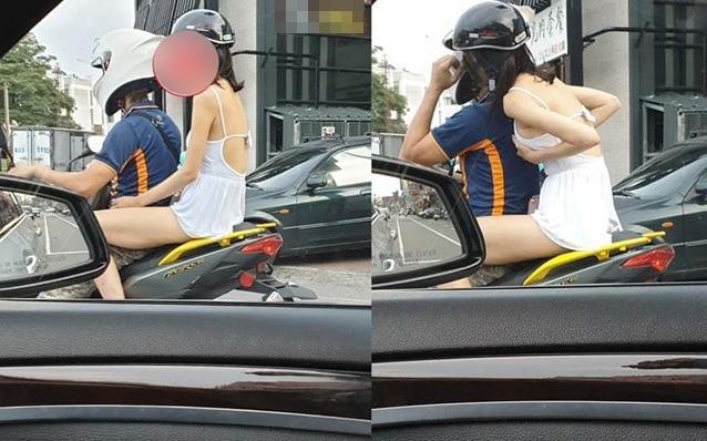 VZN News: Vi vu dạo phố, cô gái trẻ mặc váy hở trên ngắn dưới lại còn hồn nhiên đặt tay lên vòng một-1