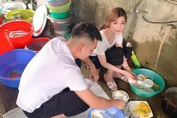 Bức ảnh gái xinh ngồi rửa đống bát sau bữa tiệc ở quê khiến các chàng trai phải truy lùng danh tính