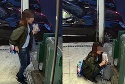 Đang đứng ăn kem, thiếu nữ đột ngột kéo quần ngồi sụp xuống làm chuyện khó tin