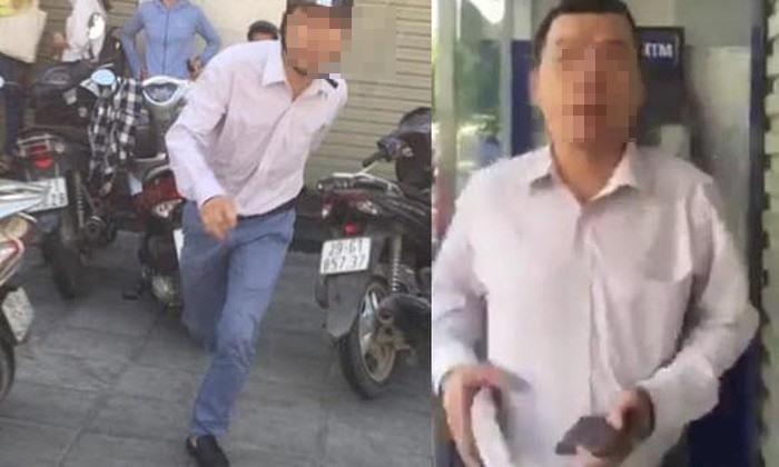 Lộ danh tính người đàn ông đánh một phụ nữ vì bị nhắc xếp hàng khi rút tiền-1