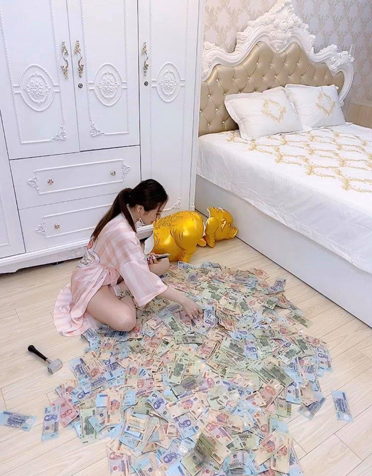 Đập lợn tiết kiệm 11 tháng được 2,8 tỷ, gái xinh khẳng định chẳng đáng là bao nhưng người xem tìm ra điểm sai-1