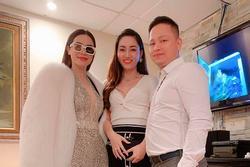 Hồ Ngọc Hà phải đeo kính râm khi chụp hình cùng vợ chồng Á hậu Ngô Trà My