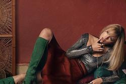 Taylor Swift trông khác lạ, diện toàn hàng hiệu trên tạp chí