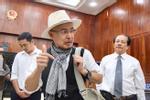 Ông Đặng Lê Nguyên Vũ ngồi lặng cả phút sau khi tòa tuyên án