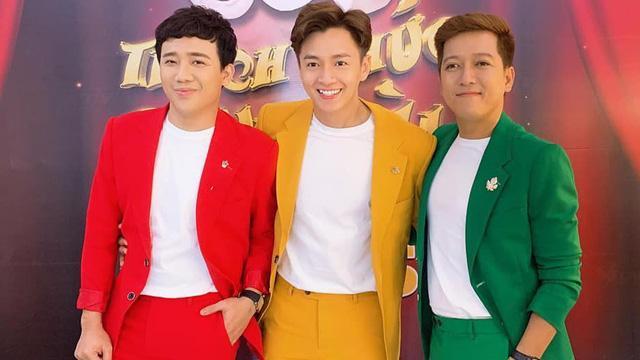 Bị chê ăn mặc giống đèn giao thông, Ngô Kiến Huy mang ngay top 3 hoa hậu ra chứng minh mình không dị-1